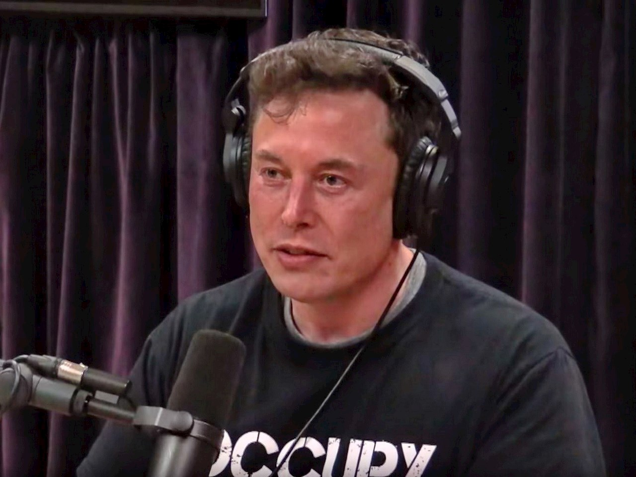 Elon Musk giving an interview at the Joe Rogan show